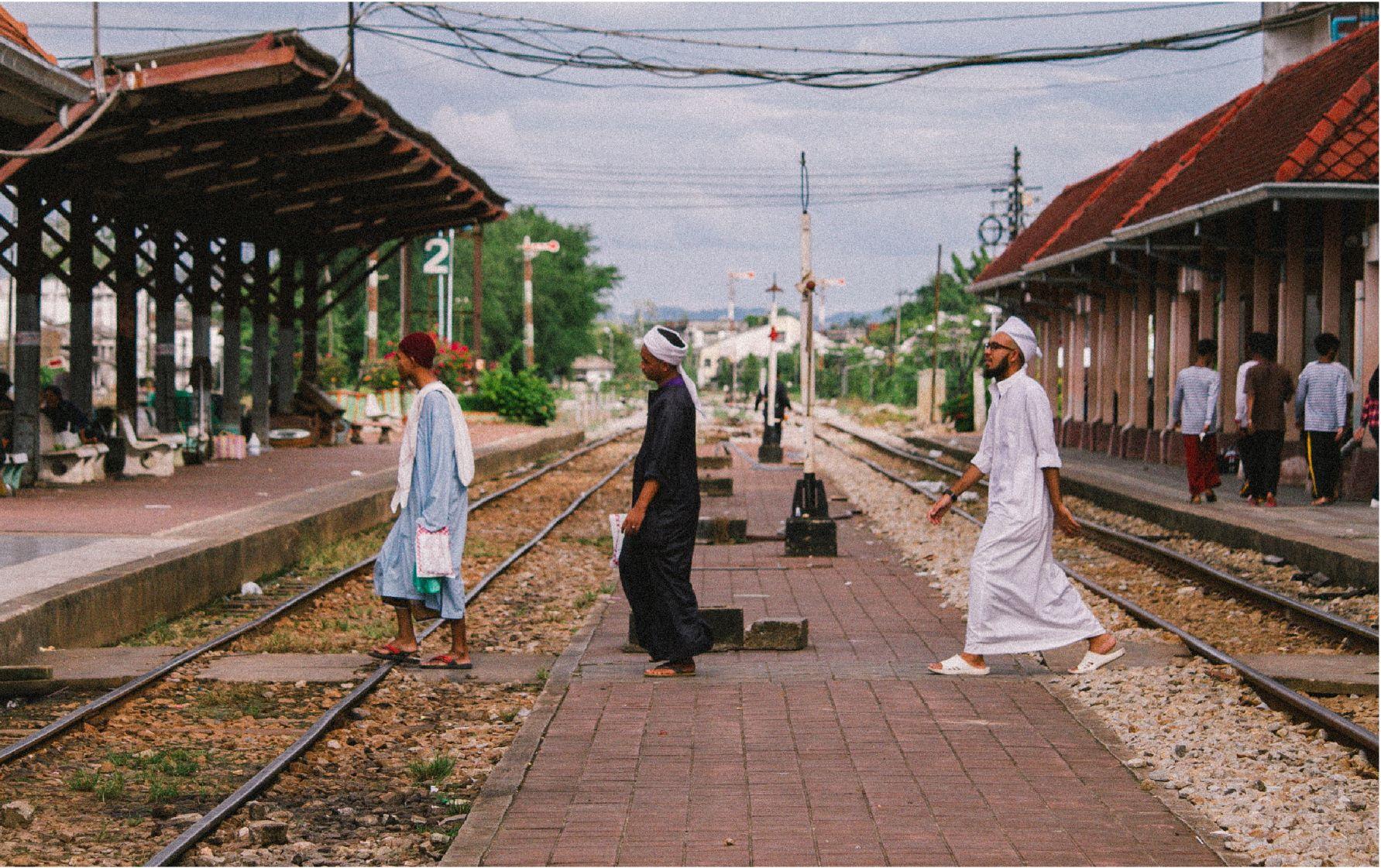 Photo of Islamic men crossing street