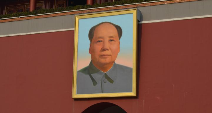 Painting of Mao hanging on building